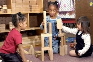 3-girls-play-with-building-blocks