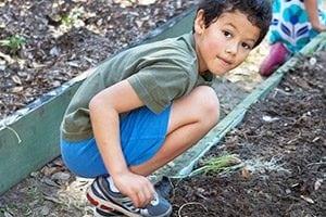 children-planting-in-community-garden