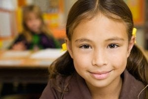 portrait-of-smiling-multiracial-girl